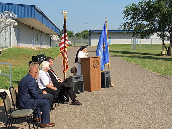Sister Pauline Quinn speaks at grand opening of the Serelda Cody Dog Training Facility