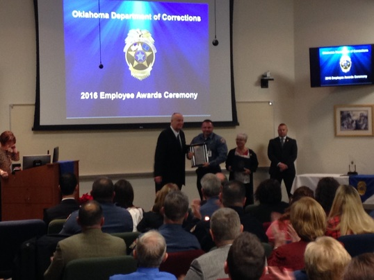 Corrections Director Joe M. Allbaugh presents the Medal of Valor to Corrections Officer Jason Lemons from the Northeast Oklahoma Correctional Center.