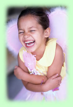Little girl dress-up laughing with wings