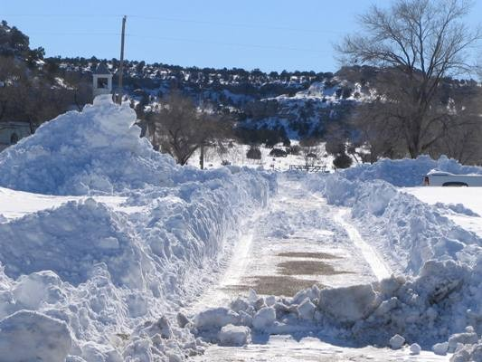 Snow drifts on side of road in Boise City