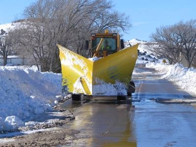 Snow plow clearing roads in Boise City